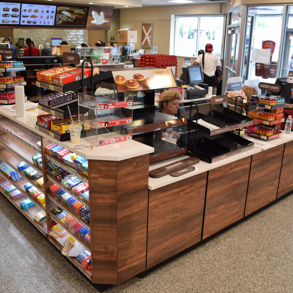 Wawa store checkout area with cashier and point-of-sale candy