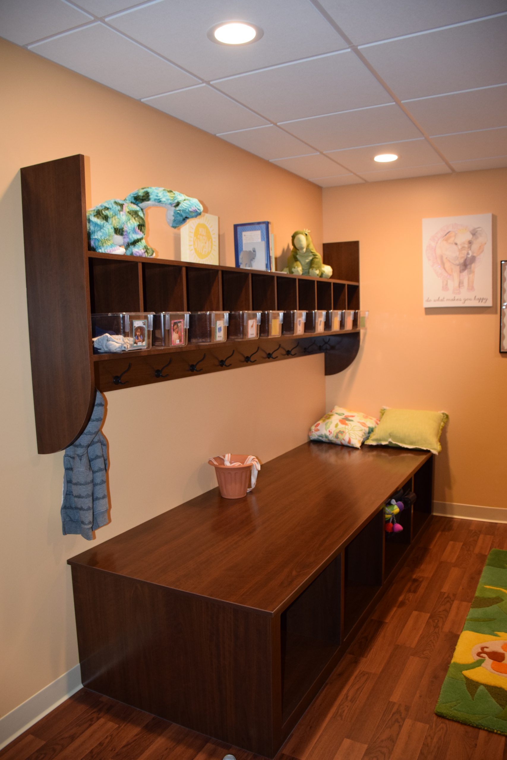 Custom Casework at a pediatric center including mounted cubbies and bench storage